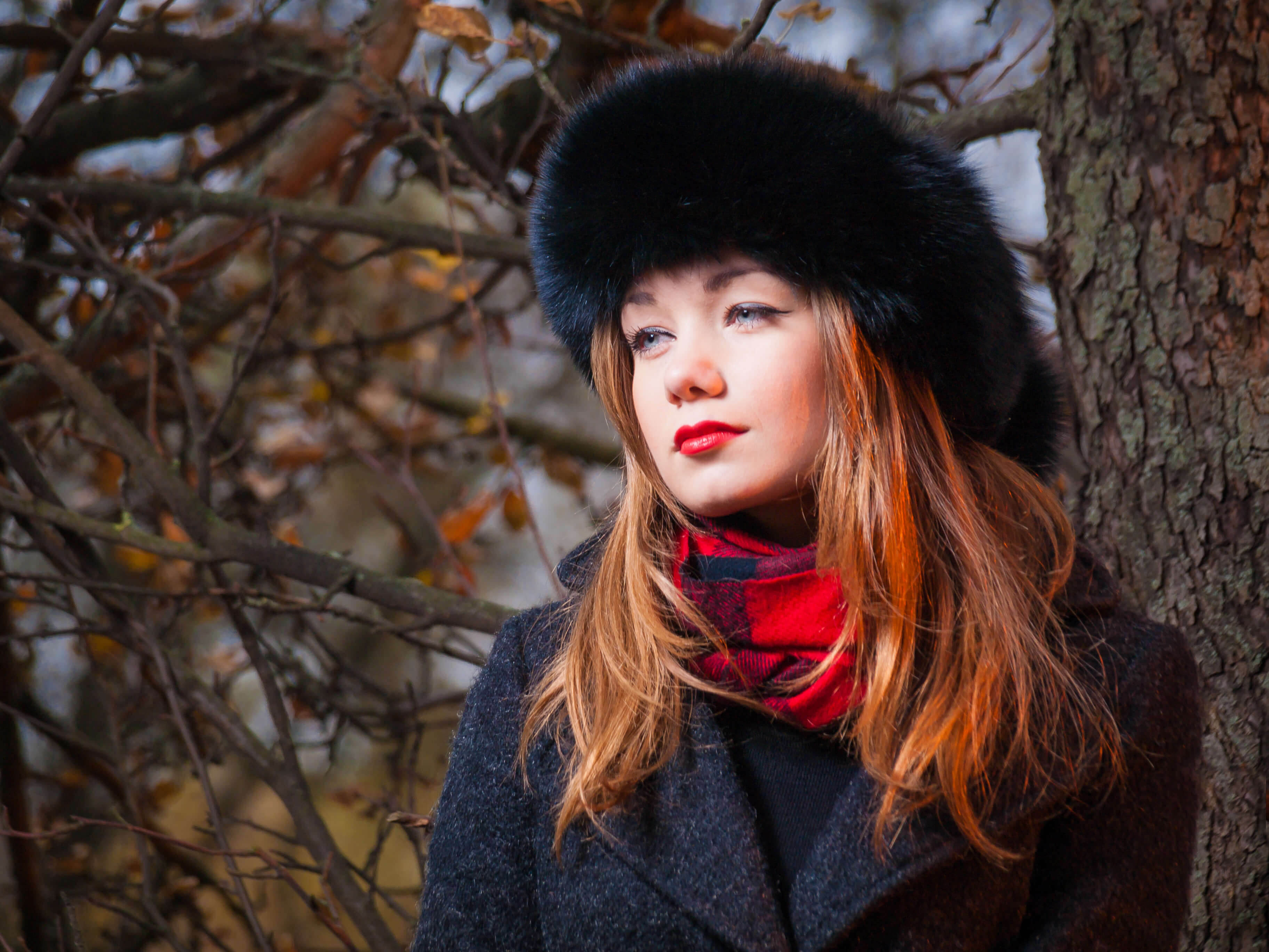 Advertising photographer that made this phot of looking girl model that dressed in a warm coat photography for a commercial project for the manufacture of warm things photo made by Fantastic Imago Branding, Advertising and Consulting Agency