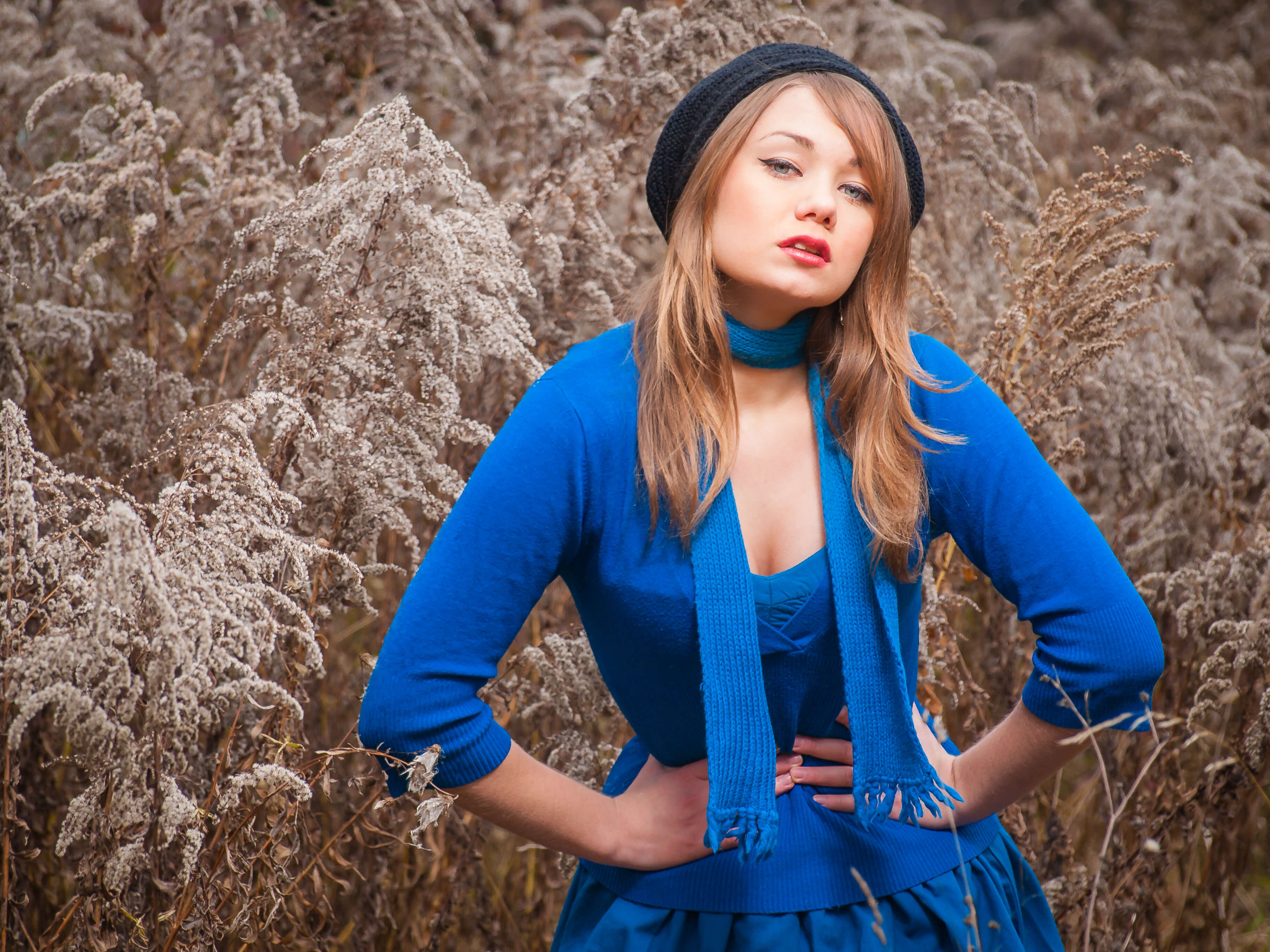 Commercial portrait fashion model girl in a blue dress in a blue scarf in a field commercial photography production of clothes and products for brands of social pages photo made by Fantastic Imago Branding, Advertising and Consulting Agency