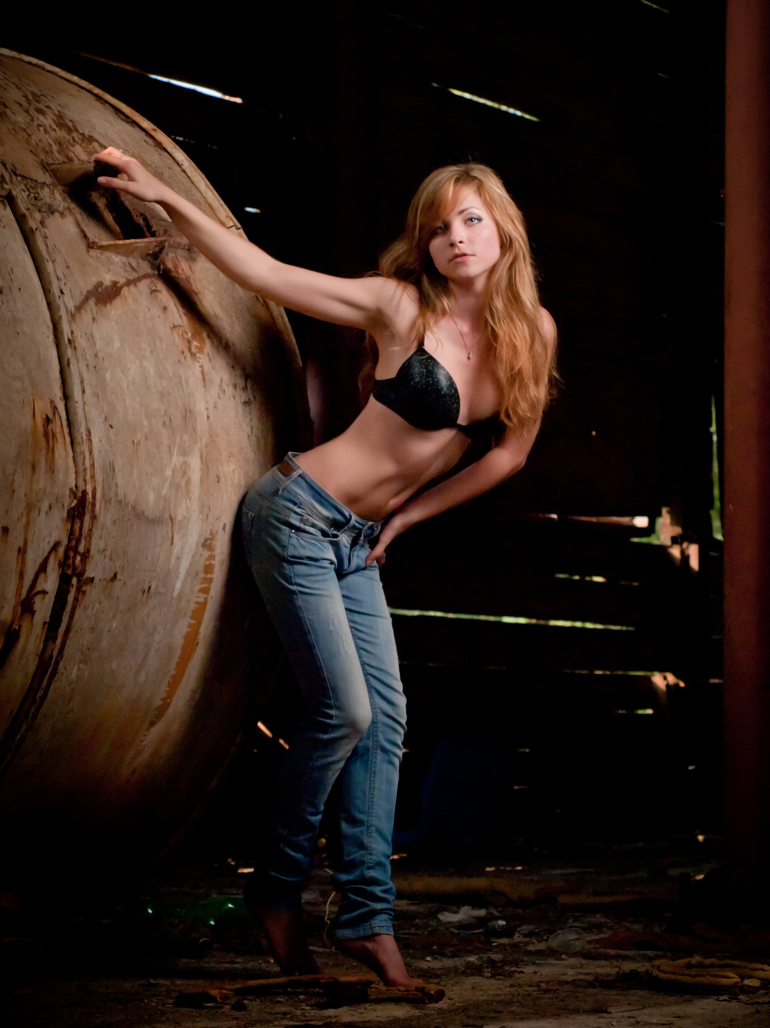 Production photography of beautiful girl model in abandoned shed near the boiler this pro photography made by Fantastic Imago Branding, Advertising and Consulting Agency